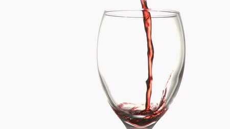 şarap cam : Red trickle in super slow motion flowing in a wine glass against a white background