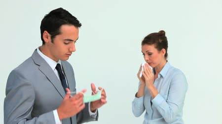 flue shot : Businessman wearing a mask because a colleague is sneezing in studio