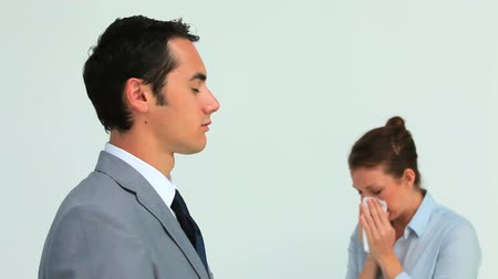 oblek : Man in suit wearing a surgical mask while a woman is sneezing against green background