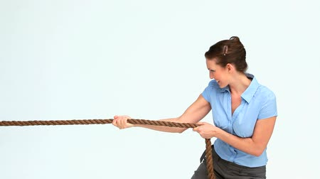 çekme : Woman in suit pulling a rope against white background