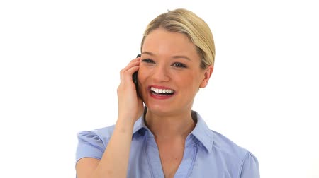 kaukázusi : Smiling blonde woman talking on the phone against a white background Stock mozgókép