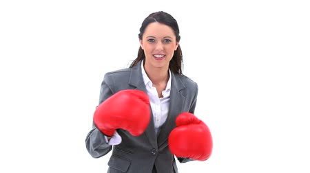 boxe : Smiling brunette boxing against a white background
