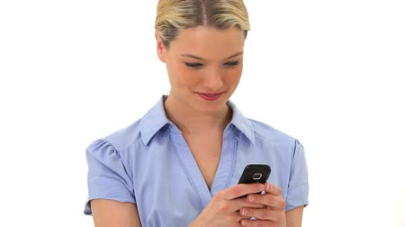 telefone celular : Blonde woman is texting against a white background