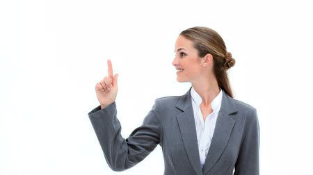 pont : Smiling woman pointing her finger up against a white background