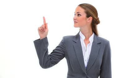 pont : Woman pointing her finger up against a white background