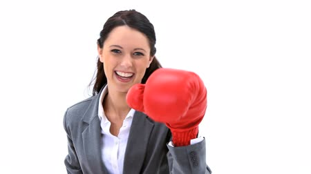 boxe : Businesswoman boxing with red gloves against a white background