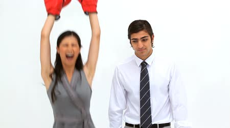 vencedor : Woman wearing boxing gloves alongside her colleague against a white background Vídeos