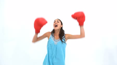 boxe : Brunette wearing box gloves against white background Vídeos