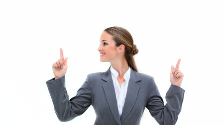 pont : Blonde businesswoman pointing her fingers up against white background Stock mozgókép