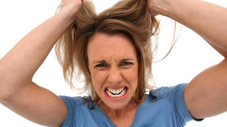 amalucado : Woman tearing her hair against white background