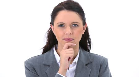 bizneswoman : Serious secretary placing her hand on her chin against a white background