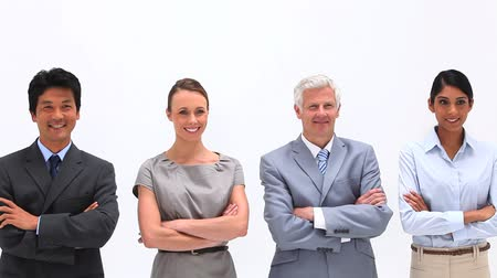 сложены : Business people with arms crossed a against a white background Стоковые видеозаписи