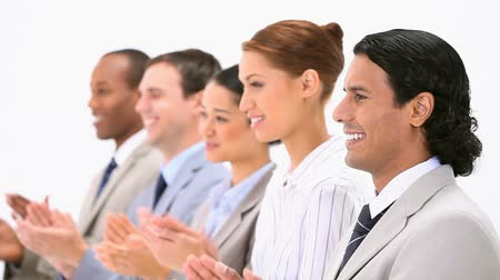 multikulturális : Business people applauding against a white background