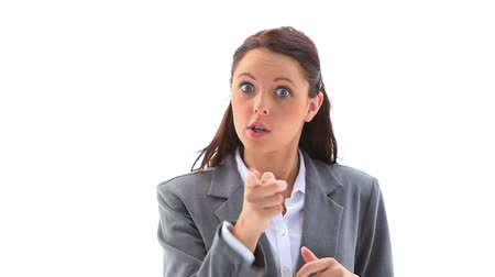 точка зрения : Angry businesswoman gesturing against a white background