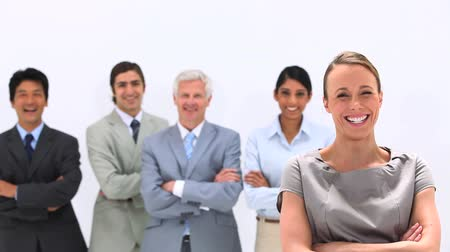 сложены : Business people laughing with their arms crossed against a white background Стоковые видеозаписи