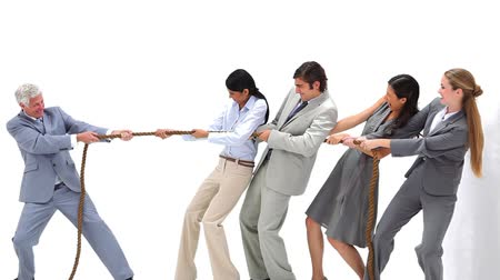 alkalmazottak : Business team playing Tug-of-War against their boss against a white background