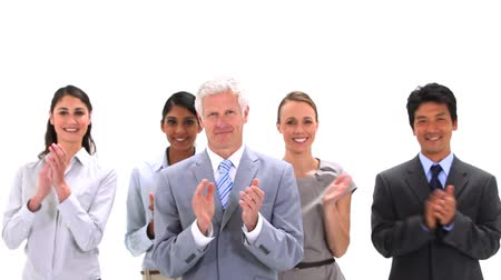 multikulturális : Business team applauding together against a white background Stock mozgókép