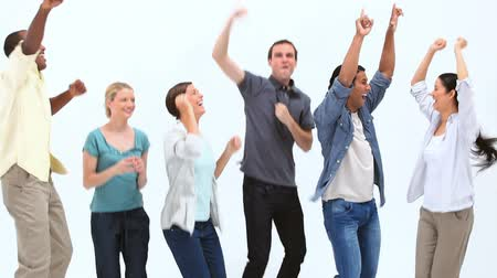 Happy people jumping against white background