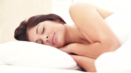 napping : Peaceful young brunette sleeping in her bedroom Stock Footage