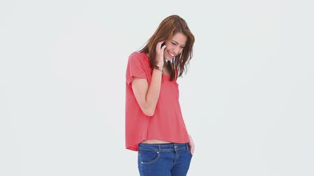 bolso : Brunette haired woman laughing on the phone against white background