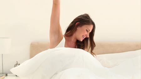 double happiness : Woman wakes up with a good mood in her bedroom