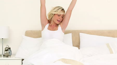 double happiness : Young blonde yawning in her bed