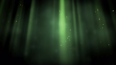 ışınları : Bright points appearing in green rays against a black background Stok Video