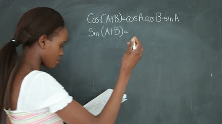 írás : Video of a student showing a blackboard in a classroom Stock mozgókép