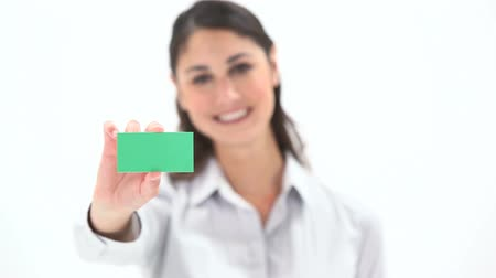 kart : Video of a woman holding a green card