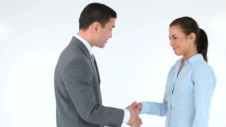 homem de negócios : Businessman and businesswoman shaking hands against a white background Vídeos