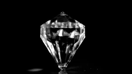 rombusz : Diamond in super slow motion spinning against a black background