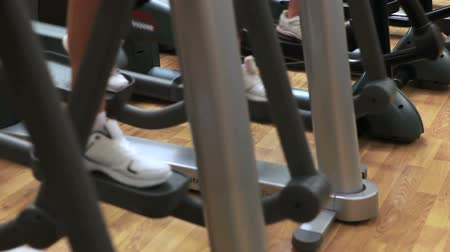 çapraz : Cross trainer being used in gym Stok Video