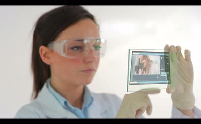 ученый : Scientist wearing protective clothes and watching holographic videos of research Стоковые видеозаписи