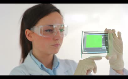 tebliğ : Scientist wearing protective clothes examing holographic chroma keys Stok Video