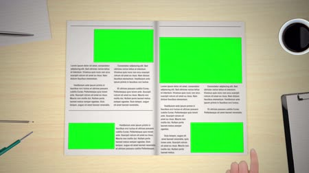 экран : Hand turning pages of newspaper with copyspaces Стоковые видеозаписи