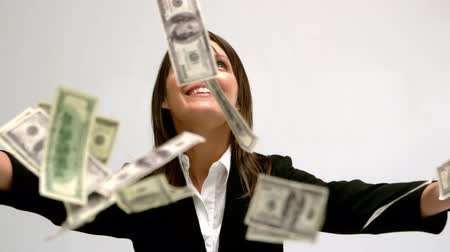 finanças : Money falling on businesswoman in slow motion