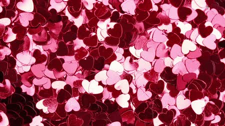 heart shaped : Glittering pink heart shaped confetti  Stock Footage