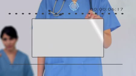 csontváz : Nurse using digital touchscreen to look at various medical images on white background