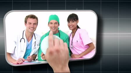 presleme : Hand selecting various medical images on black grid background