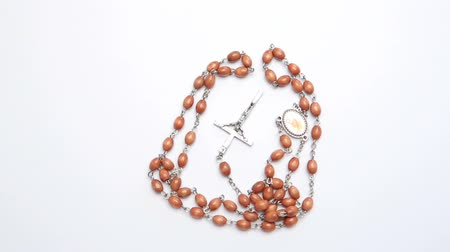 boncuklar : Rosary beads on white surface revolving video