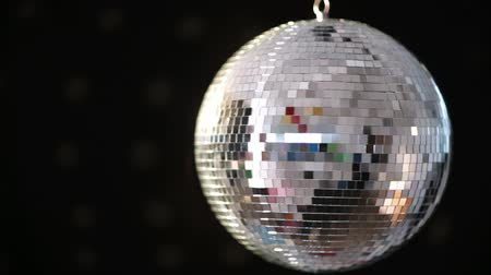 disko : Shiny disco ball revolving on black background Stok Video