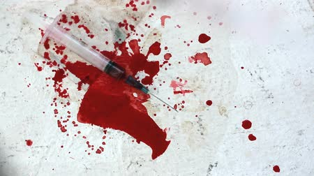 капельный : Syringes falling on white bloody surface