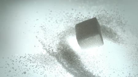kavramsal : Sugar cube falling onto pile of powdered sugar in slow motion