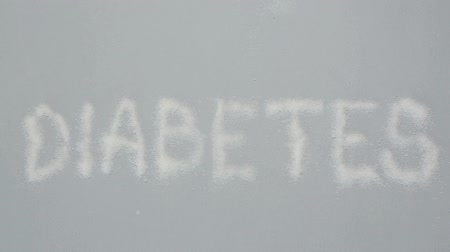glikoz : Focus on diabetes spelled out in sugar on grey background