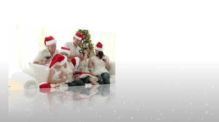 С Рождеством : Montage of family celebrating christmas on white background Стоковые видеозаписи