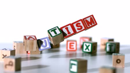 alphabet : Blocks spelling autism falling in slow motion Stock Footage