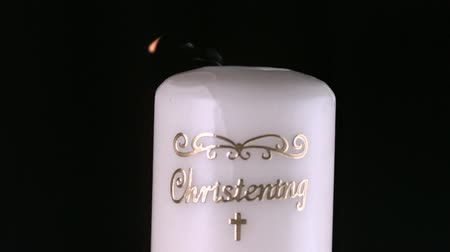 christening : Lit christening candle flickering and going out in slow motion