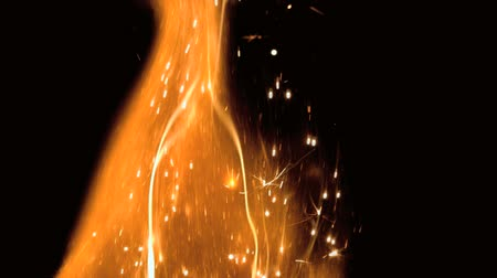 jiskří : Close up of flame with sparks in slow motion