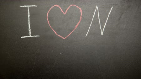 infantil : I love my mum message appearing drawn on blackboard with chalk in childish scrawl in stop motion
