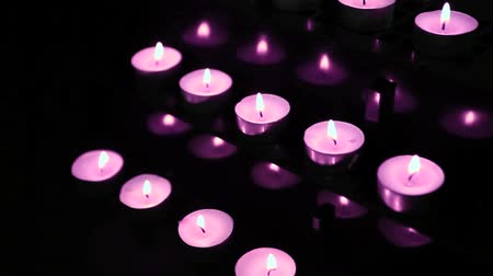esinti : Pink candles at alter flickering and blowing out  Stok Video